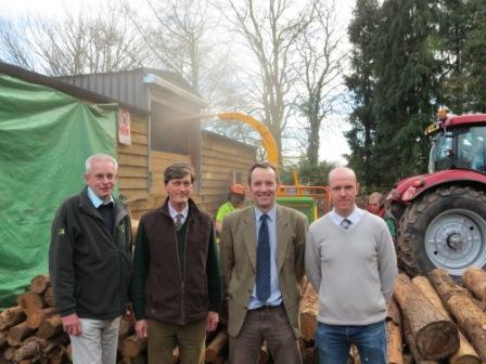 Pictured: Wood chip processing is seen behind, from left, Nick Salt, of the Forestry Commission; William Shuttleworth of Balfours with Berringtons; Graham Taylor of Pryor Ricketts Silviculture and Nick Maskery of Heartwoods.